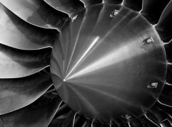 Turbine blades of a jet engine—photo by Tony Higsett [commons.wikimedia.org/wiki/File:Inlet_of_jet_engine-greyscale.jpg]