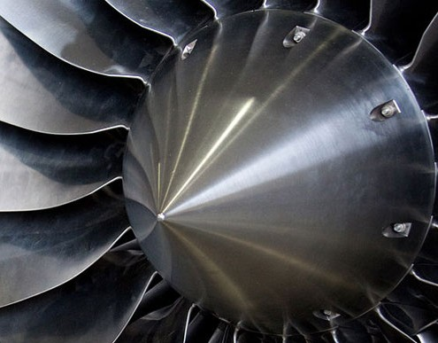 Turbine blades of a jet engine—photo by Tony Higsett [commons.wikimedia.org/wiki/File:Inlet_of_jet_engine.jpg]